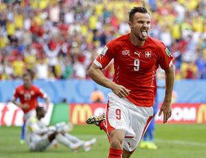 Photo - Switzerland's Haris Seferovic scores his side's second goal during the group E World Cup soccer match between Switzerland and Ecuador at the Estadio Nacional in Brasilia, Brazil, Sunday, June 15, 2014.  (AP Photo/Michael Sohn)