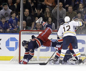 photo - New York Rangers' Rick Nash flies in front of the Buffalo Sabres goal during the overtime period of the NHL hockey game in New York, Sunday, March 3, 2013. The Rangers beat the Sabres in a shoot-out 3-2. (AP Photo/Seth Wenig)