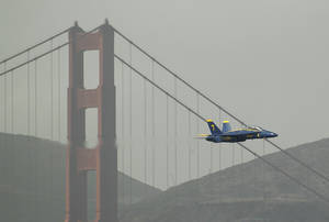 photo -   A Navy Blue Angels F/A-18 flies past the Golden Gate Bridge in San Francisco, Thursday, Oct. 4, 2012. The Blue Angels were practicing for the annual Fleet Week celebration this weekend. (AP Photo/Eric Risberg)  