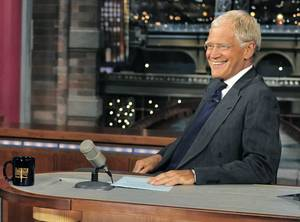 "Photo - FILE - In this July 16, 2013 file photo, host David Letterman smiles on the set of the Â""Late Show with David Letterman."" A study released Monday of gags made by late-night comics found that Obama and Democrats provided the lionÂ's share of punchlines during the first six months of the year. ThatÂ's an abrupt change from 2012, when Mitt Romney proved a gift to the comic gods.  (AP Photo/CBS, John Paul Filo)"