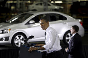 Photo - FILE - In this Friday, Oct. 14, 2011, file photo, President Barack Obama speaks at the General Motors Orion assembly plant in Orion Township, Mich. The U.S. government said Wednesday, Dec. 19, 2012, that it will sell its remaining stake in General Motors in the next year or so, winding down a $50 billion bailout that saved the iconic American car giant but also set off a heated debate about government intervention in private business that influenced this year's presidential election. (AP Photo/Carlos Osorio, File)