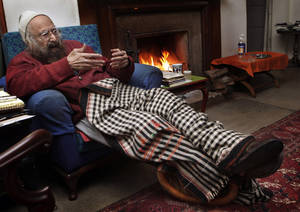Photo - FILE - In this Dec. 20, 2010 file photo, Khushwant Singh, 96, talks sitting next to a fireplace in his house in New Delhi, India. Singh, a force in India's literary world for more than 60 years, has passed away at his New Delhi home, his daughter said, Thursday, March 20, 2014. He was 99. (AP Photo/Manish Swarup, File)