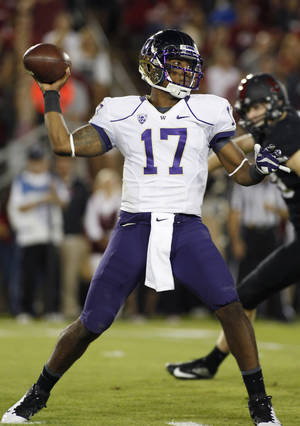 Photo - Washington quarterback Keith Price throws a pass against Stanford during the first half of an NCAA college football game in Stanford, Calif., Saturday, Oct. 5, 2013. (AP Photo/George Nikitin)