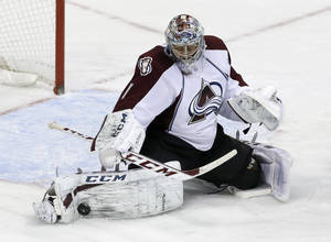 Photo - Colorado Avalanche goalie Semyon Varlamov (1), of Russia, stops a shot from the Dallas Stars in the third period of an NHL hockey game, Monday, Jan. 27, 2014, in Dallas. Varlamov made 41 saves in the 4-3 Avalanche win. (AP Photo/Tony Gutierrez)