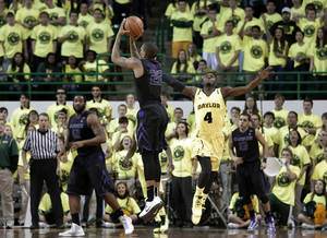 Photo - Kansas State' Rodney McGruder (22) scores a three-point basket as Baylor guard Gary Franklin (4) defends in the final second of an NCAA college basketball game on Saturday, March 2, 2013, in Waco, Texas. Kansas State won 64-61. (AP Photo/Tony Gutierrez)