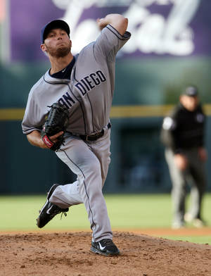 Photo - San Diego Padres starting pitcher Robbie Erlin works against the Colorado Rockies in the first inning of a baseball game in Denver on Saturday, May 17, 2014. (AP Photo/David Zalubowski)