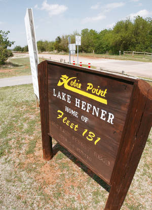 Photo - This sign marks the  Hobie Point area.  PHOTO BY PAUL HELLSTERN,  THE OKLAHOMAN