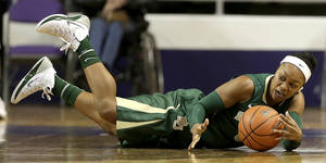 Photo - Baylor's Odyssey Sims recovers a loose ball during the first half of an NCAA college basketball game against Kansas State Thursday, Jan. 2, 2014, in Manhattan, Kan. Sims scored 40 points leading Baylor to a 92-63 win. (AP Photo/Charlie Riedel)