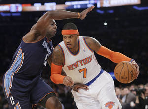 Photo - New York Knicks' Carmelo Anthony (7) drives past Charlotte Bobcats' Anthony Tolliver (43) during the first half of an NBA basketball game on Friday, Oct. 25, 2013, in New York. (AP Photo/Frank Franklin II)