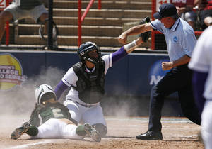 Photo - USF's Ashli Goff (2) slides and is tagged by LSU's Morgan Russell (4) during a Women's College World Series game between Louisiana State University and the University of South Florida at ASA Hall of Fame Stadium in Oklahoma City, Saturday, June 2, 2012.  Photo by Garett Fisbeck, The Oklahoman