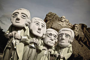 Photo - This undated photo provide by the South Dakota Department of Tourism shows The Mount Rushmore Mascots posing at the Mount Rushmore National Memorial in Keystone, S.D. The mascots are playing a big role in South Dakota's efforts to draw tourists to the state this year. (AP Photo/Courtesy of the South Dakota Department of Tourism)