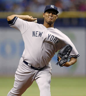 Photo - New York Yankees starting pitcher Ivan Nova throws during the first inning of a baseball game against the Tampa Bay Rays, Saturday, April 19, 2014, in St. Petersburg, Fla. (AP Photo/Mike Carlson)