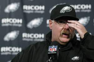 Photo - Philadelphia Eagles coach Andy Reid gestures during a news conference after the Eagles' NFL football game against the Washington Redskins, Sunday, Dec. 23, 2012, in Philadelphia. Washington won 27-20. (AP Photo/Michael Perez)