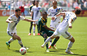 Photo - Los Angeles Galaxy defender Dan Gargan, left, Portland Timbers midfielder Steve Zakuani, center, and Los Angeles Galaxy midfielder Stefan Ishizaki (24) battle for possession Sunday, May 11, 2014, at Providence Park in Portland, Oregon. (AP Photo/The Oregonian, Thomas Boyd)  MAGS OUT; TV OUT; LOCAL TV OUT; LOCAL INTERNET OUT; THE MERCURY OUT; WILLAMETTE WEEK OUT; PAMPLIN MEDIA GROUP OUT