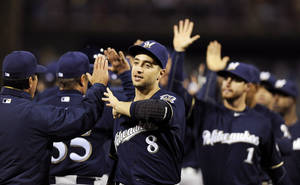 Photo - Milwaukee Brewers' Ryan Braun (8) celebrates with teammates at the end of a baseball game against the Philadelphia Phillies, Wednesday, April 9, 2014, in Philadelphia. The Brewers won 9-4. (AP Photo/Michael Perez)
