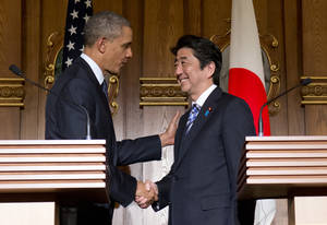 Photo - President Barack Obama, left, and Japanese Prime Minister Shinzo Abe shake hands at the conclusion of their joint news conference at the Akasaka State Guest House in Tokyo, Thursday, April 24, 2014. Obama said Thursday that he wants to see a dispute between China and Japan over islands in the East China Sea resolved peacefully, while affirming that America's mutual security treaty with Japan applies to the islands. (AP Photo/Carolyn Kaster)