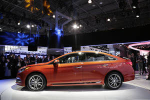 Photo - The 2015 Hyundai Sonata is introduced at the New York International Auto Show, Wednesday, April 16, 2014 in New York. (AP Photo/Mark Lennihan)