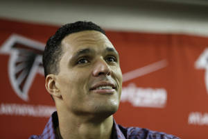 Photo - Atlanta Falcons tight end Tony Gonzalez speaks during a news conference after a NFL football game against the Carolina Panthers, Sunday, Dec. 29, 2013, in Atlanta. The Panthers won 21-20. (AP Photo/John Bazemore)
