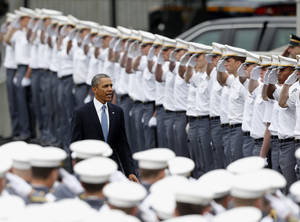 "Photo - President Barack Obama arrives to a graduation and commissioning ceremony at the U.S. Military Academy on Wednesday, May 28, 2014, in West Point, N.Y. In a broad defense of his foreign policy, the president declared  that the U.S. remains the world's most indispensable nation, even after a ""long season of war,"" but argued for restraint before embarking on more military adventures. (AP Photo/Mike Groll)"