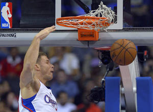 Photo - Los Angeles Clippers forward Blake Griffin dunks during the first half of an NBA basketball game against the Utah Jazz, Saturday, Dec. 28, 2013, in Los Angeles. (AP Photo/Mark J. Terrill)