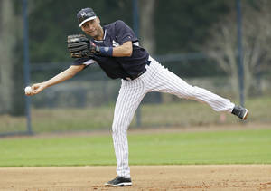 Photo - New York Yankees shortstop Derek Jeter throws to second base during spring training baseball practice Friday, Feb. 21, 2014, in Tampa, Fla. (AP Photo/Charlie Neibergall)