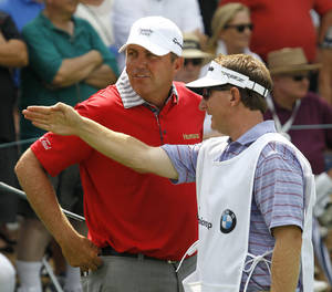 Photo -   Bo Van Pelt, left, listens to caddie Mark Chaneyto on the 10th hole during the first round of the BMW Championship PGA golf tournament at Crooked Stick Golf Club in Carmel, Ind., Thursday, Sept. 6, 2012. (AP Photo/Charles Rex Arbogast)