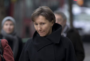 photo - FILE - Marina Litvinenko, the widow of former Russian intelligence officer Alexander Litvinenko, arrives for the first day of a scheduled two-day Pre-Inquest Review at Camden Town Hall in London, in this Thursday, Dec. 13, 2012 file photo.  British media organizations are challenging a government secrecy bid for parts of the inquest into the death of a former Russian intelligence agent poisoned in London. Alexander Litvinenko died in a London hospital in 2006, with the rare radioactive substance polonium-210 being found in his body.   (AP Photo/Matt Dunham, file)