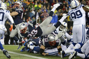 Photo - New England Patriots running back LeGarrette Blount (29) dives into the end zone for a touchdown during the first half of an AFC divisional NFL playoff football game against the Indianapolis Colts in Foxborough, Mass., Saturday, Jan. 11, 2014. (AP Photo/Matt Slocum)