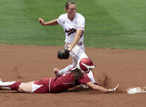 photo - OU / COLLEGE SOFTBALL / NCAA SUPER REGIONAL: Oklahoma's Brianna Turang is called out running back to second on a tag by Shelby Pendley as the University of Oklahoma Sooner softball team plays Arizona in game two of the NCAA Softball Norman Super Regional at Marita Hynes Field on Saturday, May 26, 2012, in Norman, Okla.  Head coach Patty Gasso approached the umpire and argued for a safe runner.  Photo by Steve Sisney, The Oklahoman