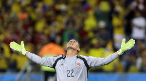 Photo - Colombia's goalkeeper Faryd Mondragon celebrates after Colombia's James Rodriguez scored his side's fourth goal during the group C World Cup soccer match between Japan and Colombia at the Arena Pantanal in Cuiaba, Brazil, Tuesday, June 24, 2014. (AP Photo/Kirsty Wigglesworth)