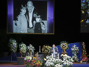 Photo - Johnny Buss speaks during a memorial service for his father Jerry Buss, the late Los Angeles Lakers owner who died Monday from cancer complications, Thursday, Feb. 21, 2013, in Los Angeles. (AP Photo/Reed Saxon)