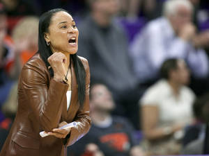 Photo - FILE - In this March 25, 2014, file photo, South Carolina head coach Dawn Staley yells to her team during the first half of a second-round game against Oregon State in the NCAA women's college basketball tournament in Seattle. After a landmark season that saw the Gamecocks earn win the Southeastern Conference regular-season title and earn a No. 1 seed in the NCAA tournament,  Staley landed the country's top college prospect in A'ja Wilson, setting off championship dreams among the fans who've gotten on board with the rising program. (AP Photo/Stephen Brashear, File)