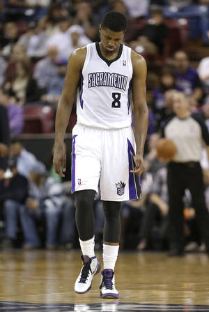 Photo - Sacramento Kings forward Rudy Gay walks down court in the closing moments of the Kings 101-92 loss to the Golden State Warriors in a NBA basketball game in Sacramento, Calif., Wednesday, Feb. 19, 2014. (AP Photo/Rich Pedroncelli)