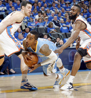 photo - Oklahoma City's Nick Collison and James Harden watch Denver's J.R. Smith fall to the court as he tries to make a play during the first round NBA Playoff basketball game between the Thunder and the Nuggets at OKC Arena in downtown Oklahoma City on Wednesday, April 20, 2011. The Thunder beat the Nuggets 106-89 and lead the series 2-0. Photo by John Clanton, The Oklahoman