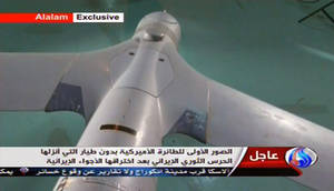 "Photo - In this image taken from the Iranian state TV's Arabic-language channel Al-Alam, showed what they purport to be an intact ScanEagle drone aircraft put on display, as an exclusive broadcast Tuesday Dec. 4, 2012, showing what they say are the first pictures of a captured drone.  Iran authorities claimed Tuesday it had captured a U.S. drone after it entered Iranian airspace over the Persian Gulf,  and showing an image of a purportedly downed craft on state TV,  but the U.S. Navy said all its unmanned aircraft in the region were ""fully accounted for.""(AP Photo / Al-Alam TV)  TV OUT"