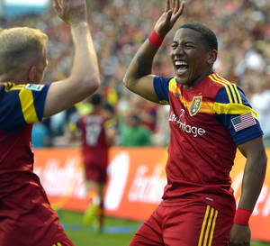 Photo - Real Salt Lake midfielder Luke Mulholland, left, congratulates Jou Plata (8) after Plata's goal in the first period of their MLS soccer match against the Colorado Rapids, Saturday, May 17 2014, in Sandy, Utah. (AP Photo/The Salt Lake Tribune, Rick Egan)  DESERET NEWS OUT; LOCAL TV OUT; MAGS OUT.