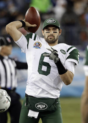 photo - FILE - New York Jets quarterback Mark Sanchez throws on the sideline in the second quarter of an NFL football game against the Tennessee Titans on in this Dec. 17, 2012 file photo taken in Nashville, Tenn. Mark Sanchez knows he won't be the New York Jets' starting quarterback Sunday Dec. 23, 2012. Beyond that, the one-time face of the franchise won't say whether he thinks he'll be back with the team next season. (AP Photo/Wade Payne, File)