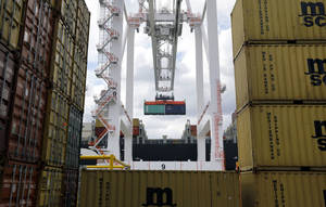 Photo - In this March 1 photo, a crane removes a container from a ship at the Port of Baltimore's Seagirt Marine Terminal in Baltimore. The government issues its third and final estimate of economic growth in the January-March quarter, Wednesday. AP Photo/Patrick Semansky, File <strong>Patrick Semansky - AP</strong>