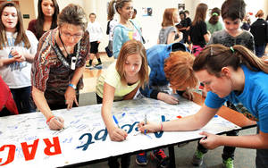 photo - Cheyenne Middle School students and faculty sign the Rachel's Challenge banner. Photo by Jim Beckel, The Oklahoman