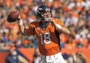 Photo - Denver Broncos quarterback Peyton Manning (18) passes the ball against the Philadelphia Eagles in the first quarter of an NFL football game, Sunday, Sept. 29, 2013, in Denver. (AP Photo/Jack Dempsey)