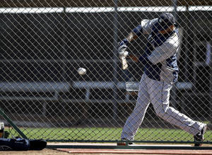Photo - Seattle Mariners' Robinson Cano takes a swing as he participates in batting drills during baseball spring training, Wednesday, Feb. 26, 2014, in Peoria, Ariz. (AP Photo/Tony Gutierrez)