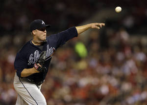 Photo - Atlanta Braves starting pitcher Paul Maholm throws during the third inning of a baseball game against the St. Louis Cardinals, Thursday, Aug. 22, 2013, in St. Louis. (AP Photo/Jeff Roberson)