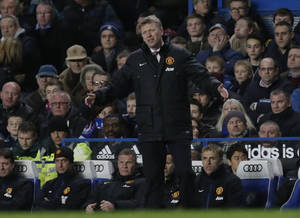 Photo - Manchester United's manager David Moyes lifts his arms as he watches his side play Chelsea during the English Premier League soccer match between Chelsea and Manchester United at Stamford Bridge stadium in London, Sunday, Jan. 19, 2014. (AP Photo/Matt Dunham)