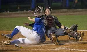 Photo - Kentucky's A.J. Reed, left, collides with Mississippi State catcher Gavin Collins, right, and is safe at home during the Southeastern Conference NCAA college baseball tournament on Thursday, May 22, 2014, in Hoover, Ala. (AP Photo/Hal Yeager)