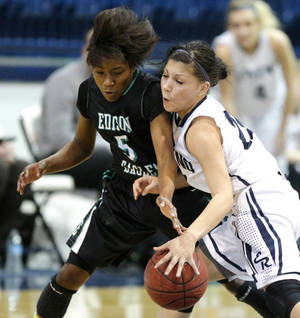 Photo - El Reno's Teresa Blurton, right, runs into Tulsa Edison's Shala Dobbins during action on Friday at the Shawnee Invitational. Tulsa Edison was playing Shawnee late Saturday in the championship game. Photo by Bryan Terry, The Oklahoman