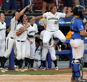 Photo -                    Baylor's Sam Montes, center, leaps in the air in reaction to a tying run against Kentucky on Saturday.                                                                             Photo by Steve Sisney, The Oklahoman