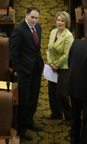 Photo - Reps. Scott Martin and Pam Peterson speak on the floor of the House as it takes up the income-tax cutting bill on Wednesday in Oklahoma City.  Photo by Steve Sisney, The Oklahoman <strong>STEVE SISNEY</strong>