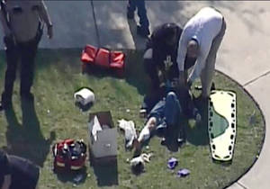 photo - In this frame grab provided by KPRC Houston, an unidentified person is attended to by emergency personnel at Lone Star College Tuesday, Jan. 22, 2013, in Houston, where law enforcement officials say the community college is on lockdown amid reports of a shooter on campus.  (AP Photo/Courtesy KPRC TV) MANDATORY CREDIT