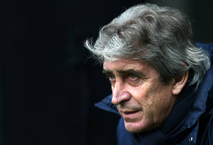 Photo - Manchester City's manager Manuel Pellegrini looks on ahead of their English Premier League soccer match against Newcastle United at St James' Park, Newcastle, England, Sunday, Jan. 12, 2014. (AP Photo/Scott Heppell)
