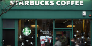 "Photo - FILE - This is a Monday, Dec.  3, 2012 file photo  pedestrians walk past a branch of the Starbucks shop chain in west  London.  Starbucks bowed to mounting pressure over its tax affairs in Britain and revealed Thursday Dec. 6, 2012  that it would pay about 10 million pounds ($16 million) in each of the next two years. Having been slammed by the country's lawmakers of ""immorally"" avoiding tax, Starbucks' U.K. managing director Kris Engskov said the firm had agreed to pay more than required by law. ""With the backdrop of these difficult times, in the area of tax, our customers clearly expect us to do more,"" he told the London Chamber of Commerce.(AP Photo/Alastair Grant, File)"
